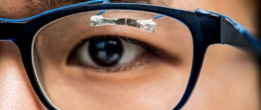 Closeup of eyeglasses with embedded tissue paper sensor